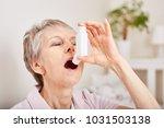 senior woman holds inhaler for...   Shutterstock . vector #1031503138