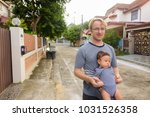 portrait of father and baby son ... | Shutterstock . vector #1031526358