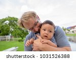 portrait of father and baby son ... | Shutterstock . vector #1031526388