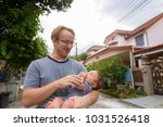 portrait of father and baby son ... | Shutterstock . vector #1031526418