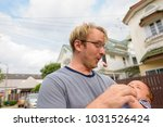 portrait of father and baby son ... | Shutterstock . vector #1031526424