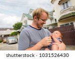 portrait of father and baby son ... | Shutterstock . vector #1031526430