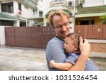 portrait of father and baby son ... | Shutterstock . vector #1031526454