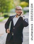 successful smart businessman in ... | Shutterstock . vector #1031531104