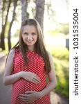 happy beautiful pregnant girl... | Shutterstock . vector #1031535004