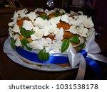a wedding cake | Shutterstock . vector #1031538178