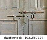 ancient metal door  weathered... | Shutterstock . vector #1031557324