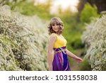 outdoor spring portrait of a... | Shutterstock . vector #1031558038