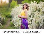 outdoor spring portrait of a... | Shutterstock . vector #1031558050