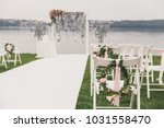 outdoor wedding ceremony | Shutterstock . vector #1031558470