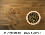 capers pickled in vinegar and... | Shutterstock . vector #1031560984