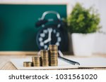 step of coins stacks and alarm...   Shutterstock . vector #1031561020