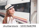 traveler girl waiting and ... | Shutterstock . vector #1031568298