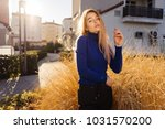 stylish young blonde girl in... | Shutterstock . vector #1031570200