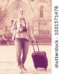 smiling young tourist blond... | Shutterstock . vector #1031571478