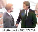 handshake business partners to... | Shutterstock . vector #1031574238