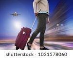 girl walking with suitcase on... | Shutterstock . vector #1031578060
