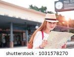 traveler girl waits train on... | Shutterstock . vector #1031578270