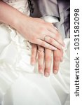 newly wed couple's hands with... | Shutterstock . vector #1031582098