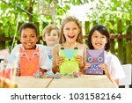 multicultural group of kids... | Shutterstock . vector #1031582164