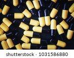 pills in capsules | Shutterstock . vector #1031586880