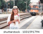traveler girl with map  hat and ... | Shutterstock . vector #1031591794