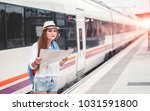 traveler girl with map  hat and ... | Shutterstock . vector #1031591800