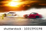 Small photo of Abstract blurred two drifting cars battle on speed track, sport concept.