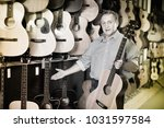 adult glad cheerful  guitarist... | Shutterstock . vector #1031597584