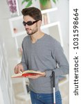 blind man reading at home | Shutterstock . vector #1031598664