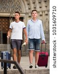 men travelers with luggage... | Shutterstock . vector #1031609710