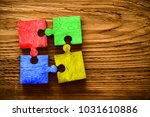 four wooden jigsaw puzzle... | Shutterstock . vector #1031610886