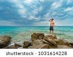 traveler shirtless standing on... | Shutterstock . vector #1031614228