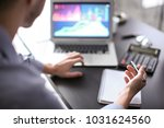 man working at table in office  ... | Shutterstock . vector #1031624560