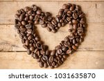 coffee beans in the wood. ... | Shutterstock . vector #1031635870