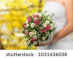 bride holds a wedding bouquet | Shutterstock . vector #1031636038