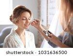 makeup artist preparing bride... | Shutterstock . vector #1031636500