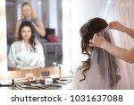 hairdresser preparing bride... | Shutterstock . vector #1031637088