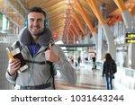 satisfied traveler giving a... | Shutterstock . vector #1031643244