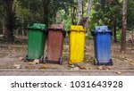 trash of various colors lined. | Shutterstock . vector #1031643928