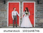 stylish bride and groom posing... | Shutterstock . vector #1031648746