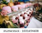 raspberry cake on wedding table ... | Shutterstock . vector #1031654608