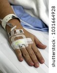 iv solution in a patients hand   Shutterstock . vector #1031664928