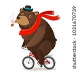happy bear riding bike.... | Shutterstock .eps vector #1031670739