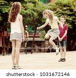 happy boy and girls in... | Shutterstock . vector #1031672146
