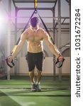 handsome muscular man training... | Shutterstock . vector #1031672284
