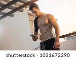 handsome muscular man with... | Shutterstock . vector #1031672290