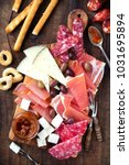 cured meat and cheese platter... | Shutterstock . vector #1031695894
