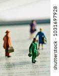 some miniature traveler people... | Shutterstock . vector #1031697928