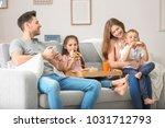 happy family having breakfast... | Shutterstock . vector #1031712793